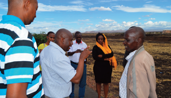 The Kiwanjani Location Chief takes researchers on a site visit to Isiolo Airport, Kenya