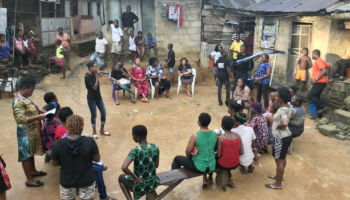 Paralegals make an outdoor presentation to community members in Elechi, Port Harcourt, Nigeria.