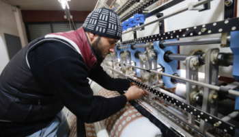 A Syrian refugee at work in a Lebanese textile factory supported by UK aid and Mercy Corps.