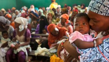 Mothers wait to vaccinate their babies